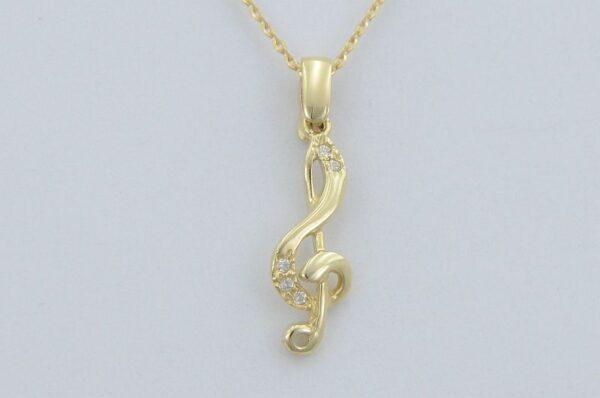 Ženski ali otroški obesek iz rumenega zlata violinski ključ s cirkoni