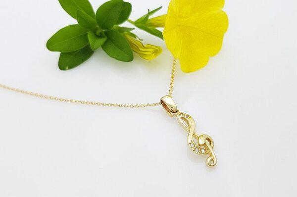 Ženski obesek iz rumenega zlata, violinski ključ s cirkoni