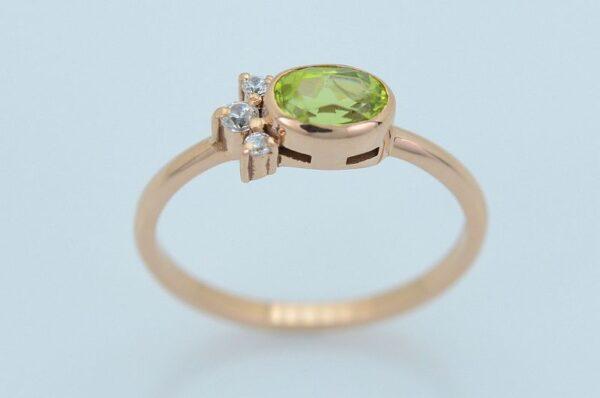 Ženski prstan iz rdečega zlata s cirkoni oval Peridot