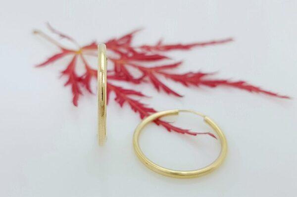 Okrogli ženski uhani iz rumenega zlata